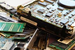E-scrap. Used computer parts: memory, network cards, disks, graphics cards royalty free stock photo
