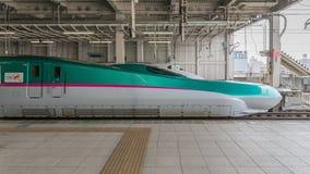 E5 Series bullet (High-speed or Shinkansen) train. TOKYO-April 14,2016:The green E5 Series bullet (High-speed) train. It services as Hayabusa(Falcon) or Hayate Stock Photos