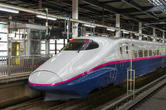 The E2 Series bullet (High-speed or Shinkansen) train. TOKYO-April 19,2016:Side view of the E2 Series bullet (High-speed or Shinkansen) train. This train Stock Image