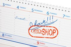 E-shop. Quick e-shop purchase recorded in the calendar on white background Royalty Free Stock Photo