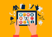 E-shopping concept. Hands touching a tablet with shopping icons. Stock Images