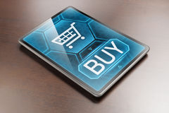 E-shopping. Modern tablet displaying a purchase on internet Royalty Free Stock Photography