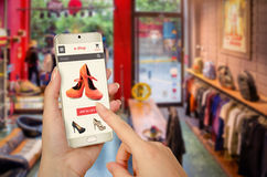 E shopping with smart phone with woman hand Stock Image