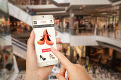 E shopping with smart phone with woman hand. Online shopping with smart phone with woman hand Royalty Free Stock Image