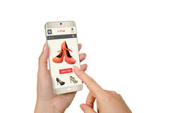 E shopping with smart phone in woman hand. Online shopping with smart phone in woman hand Royalty Free Stock Photos