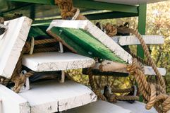 Construction planks of wood painted green and white with ropes a. E shot of wooden planks painted green and white with ropes attached to them. These are standard Stock Photography