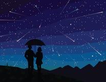 E Silhouet van paar onder paraplu, het letten op dalende sterren Royalty-vrije Stock Foto