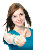 Żeński nastolatek pokazuje aprobaty Obrazy Royalty Free
