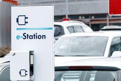 E-Station for charging of cars. Charing station for electric cars on a parking lot Royalty Free Stock Photography