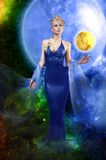 E.T. lady with golden planet stock image