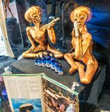 E.T. Smokes a Joint. Amsterdam, Netherlands - Mar 24, 2016: E.T. Smokes a Joint in a shop window Stock Image