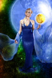 E.T. woman with golden planet Royalty Free Stock Photography