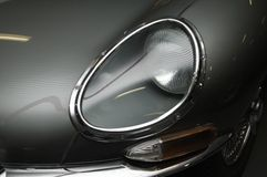 E-Type Jaguar Front Headlight. The front left headlight of a Jaguar E-Type stock image
