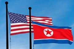 E.U. e bandeiras norte-coreanas Foto de Stock