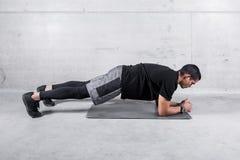 Sportsman in plank posture training abdomen royalty free stock photos