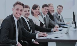 Company`s shareholders at a meeting at work, sitting at a table Stock Image