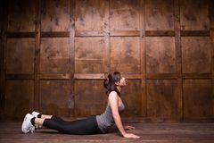 Fitness and exercice concept. E view image of girl. Lying on floor in gym Royalty Free Stock Photo