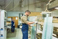 Busy Workers at Modern Furniture Factory stock image