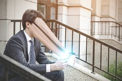 Man sucked into a smartphone Stock Images