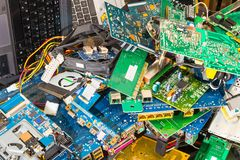 E-waste pile from discarded laptop parts stock images