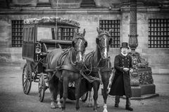Lovely carriage with two horses in front of the Royal palace on Dam Square Royalty Free Stock Photo