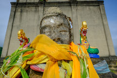 Ead Buddha statue left in the forest for hundred years in wiwekaram temple. Stock Images