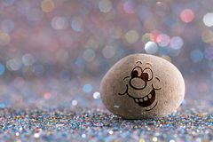 The Eager stone emoji. Emotions on color glitter boke background stock photo