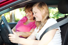 Eager to Drive. Teenage girl eager to start a driving lesson with her mother or an instructor Royalty Free Stock Photography