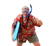 Eager tourist ready for fun. Eager senior tourist with floral shirt, surfboard, and snorkel mask on a tropical beach, isolated Royalty Free Stock Image