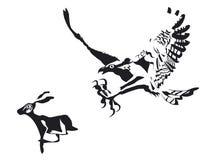 Eagle-attak ein Kaninchen für das Essen Lizenzfreie Stockfotos