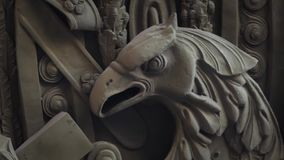 Eagle bas Relief. Predatory eagle bas Relief zoom out stock footage