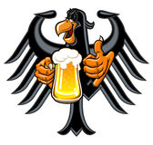 Eagle with beer. Cartoon eagle holding a mug of beer Royalty Free Stock Images