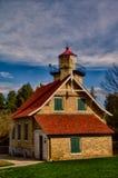 Eagle Bluff Lighthouse i sommar, Door County, WI Arkivfoton