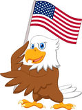 Eagle cartoon holding American flag Stock Image