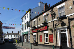 Eagle and Child High Street Garstang Lancashire. View along High Street in Garstang, Lancashire, England looking past the Eagle & Child pub towards the Market Royalty Free Stock Photo