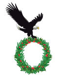 Eagle with Christmas wreath Royalty Free Stock Photography