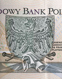 Eagle, das Emblem von Polen stellte auf Zlotybanknotenmakro dar Stockfotos