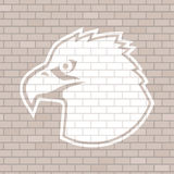 Eagle face draw in brick wall Stock Photos