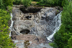 Eagle Falls. Gorgeous Eagle Falls cascades down the cliff face on it s was to Lake Superior  Located in Eagle Harbor, Michigan Royalty Free Stock Photos