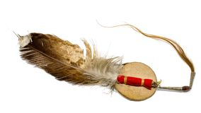 Eagle feather with horse hair as Indian hair accessory. Isolated on white stock photo