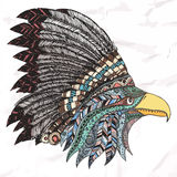Eagle in feathered tribal headdress. Royalty Free Stock Photos