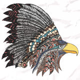 Eagle in feathered tribal headdress. Royalty Free Stock Image
