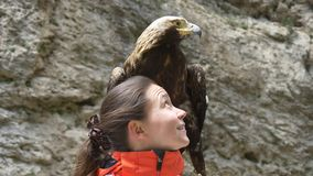 Eagle and girl. Look at each other stock video footage