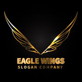 Eagle gold wings logo design luxury on black background vector Stock Images