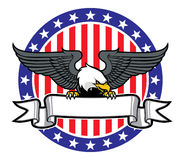 Eagle grip a ribbon with US flag as background Stock Photo