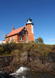 Eagle Harbor Lighthouse and Cliff Stock Image