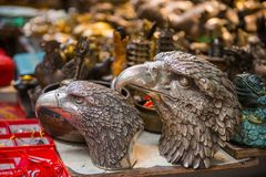 Eagle head statue for sale at Upper Lascar Row historical market. Hong Kong royalty free stock images