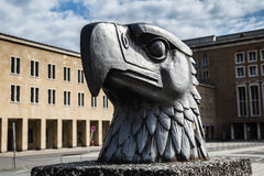 Eagle head stature at Tempelhof Airport, Berlin. The famous eagle had monument in front of the Tempelhof Airport, Berlin Royalty Free Stock Image