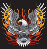 Eagle holding motorcycle engine with flames Royalty Free Stock Images