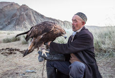 Eagle hunter holding his eagle Stock Photo